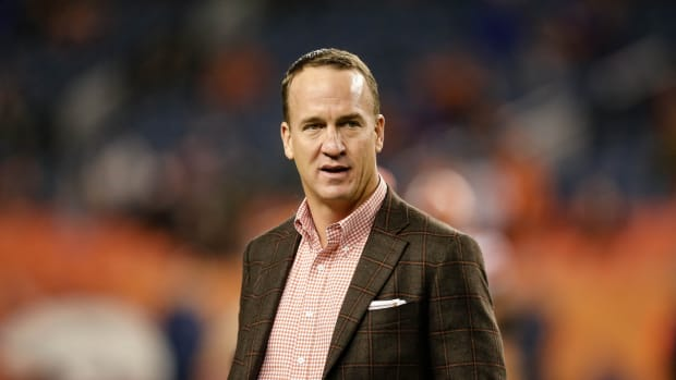 Former Denver Broncos player Peyton Manning before the game against the Cleveland Browns at Broncos Stadium at Mile High.
