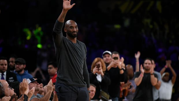 Nov 17, 2019; Los Angeles, CA, USA; Former Lakers player Kobe Bryant acknowledges the crowd during the second quarter against the Atlanta Hawks at Staples Center. (Kelvin Kuo-USA TODAY Sports)