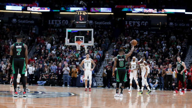Celtics' Kemba Walker holds the ball for a 24-second violation in honor of Kobe Bryant vs. Pelicans