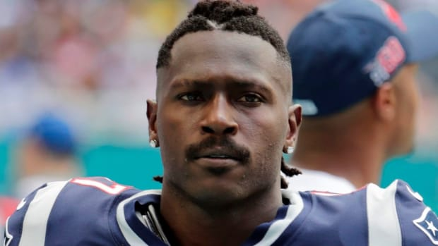 New England Patriots wide receiver Antonio Brown on the sidelines, during the first half at an NFL football game against the Miami Dolphins in Miami Gardens, Fla.