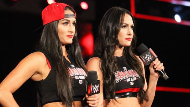 WWE's Nikki and Brie Bella (the Bella Twins) on the microphone on Raw