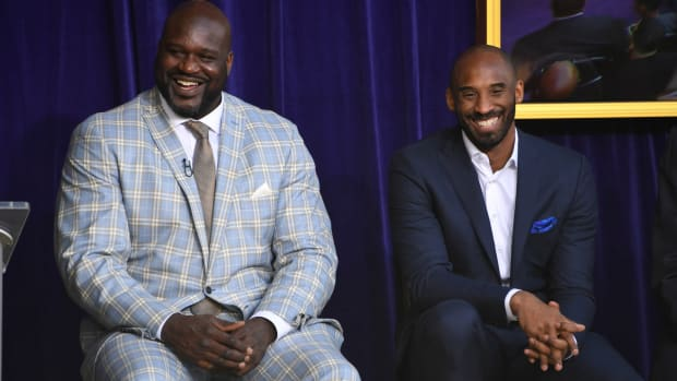 Los Angeles Lakers former center Shaquille O'Neal and guard Kobe Bryant react during ceremony to unveil statue of O'Neal at Staples Center.