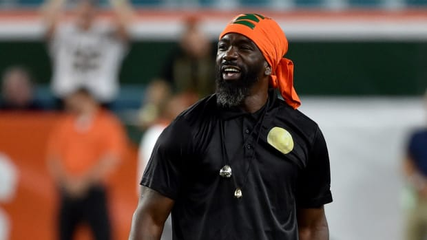 Miami Hurricanes former player Ed Reed was made an honorary captain before a game against Notre Dame Fighting Irish at Hard Rock Stadium