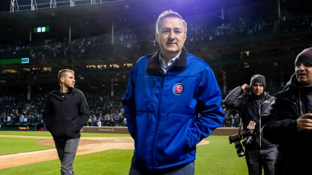 Cubs owner Tom Rickets walks on the grass at Wrigley Field