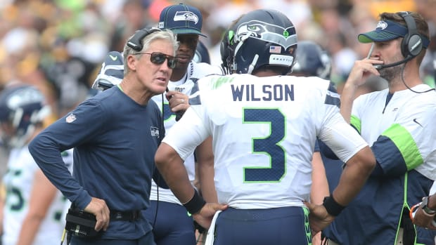Seattle Seahawks head coach Pete Carroll (left) talks with quarterback Russell Wilson (3) on the sidelines during the second quarter against the Pittsburgh Steelers at Heinz Field.