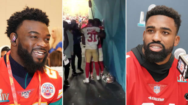 Chiefs' Damien Williams and 49ers' Raheem Mostert trade jerseys after Super Bowl LIV in Miami