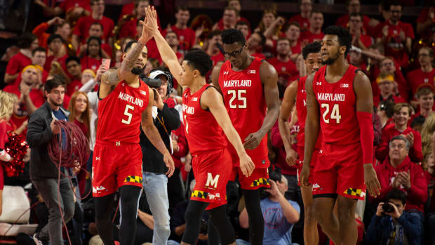 Maryland Terrapins guard Eric Ayala (5) and guard Anthony Cowan Jr. (1) react after Iowa Hawkeyes calls a time out during the second half at XFINITY Center.