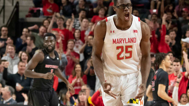 Maryland Terrapins forward Jalen Smith (25) reacts after making a three point shot during the first half against the Rutgers Scarlet Knights at XFINITY Center.