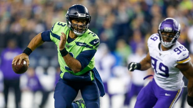 Seattle Seahawks quarterback Russell Wilson (3) scrambles out of the pocket against the Minnesota Vikings during the second quarter at CenturyLink Field.