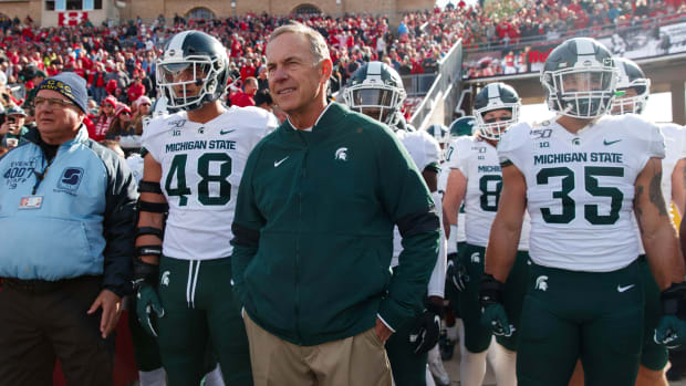 Michigan State head coach Mark Dantonio walks on the field with his players