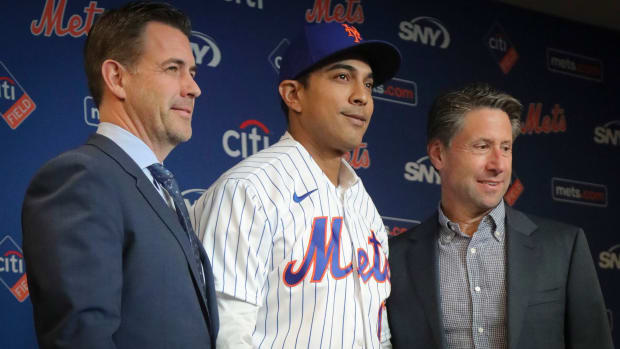 New York Mets new manager Luis Rojas, center, poses with Mets executive vice president & general manager Brodie Van Wagenen, left, and Mets owner Jeff Wilpon after his introduction at a news conference, in New York.