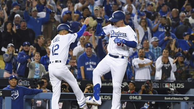 Oct 3, 2019; Los Angeles, CA, USA; Los Angeles Dodgers left fielder Joc Pederson (31) celebrates with third base coach Dino Ebel (12) after a solo home run during the eighth inning in game one of the 2019 NLDS playoff baseball series against the Washington Nationals at Dodger Stadium.