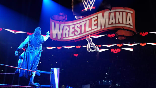 WWE's Drew McIntyre points at the WrestleMania sign during Raw