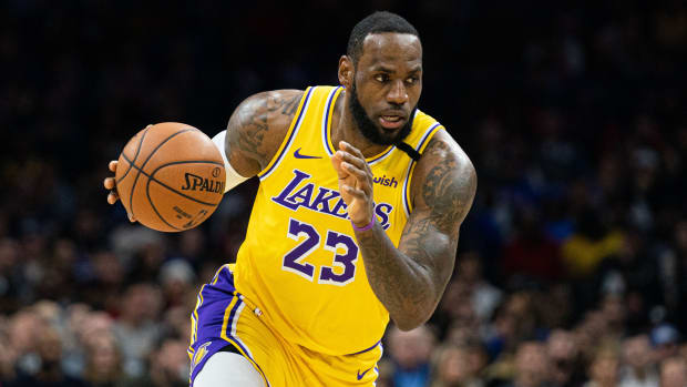 Lakers' LeBron James dribbles down the court