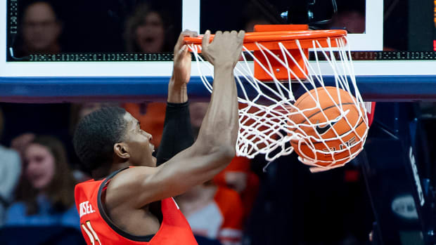 Maryland Terrapins guard Darryl Morsell (11) slam dunks during the first half against the Illinois Fighting Illini at State Farm Center.