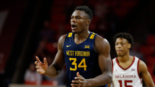 West Virginia Mountaineers forward Oscar Tshiebwe (34) is surprised by a call against him on a play against the Oklahoma Sooners during the second half at Lloyd Noble Center. Oklahoma won 69-59.