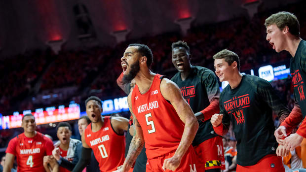 Maryland Terrapins guard Eric Ayala (5) celebrates a foul after making a layup during the second half against the Illinois Fighting Illini at State Farm Center.