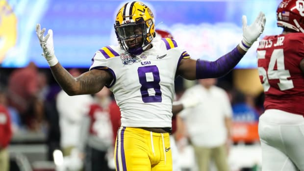 Dec 28, 2019; Atlanta, Georgia, USA; LSU Tigers linebacker Patrick Queen (8) reacts during the second quarter of the 2019 Peach Bowl college football playoff semifinal game against the Oklahoma Sooners at Mercedes-Benz Stadium.