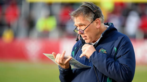 Jim Zorn, head coach of XFL's Seattle Dragons, stands on the sideline ready to call in a play