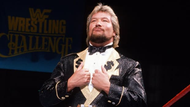"""The Million Dollar Man"" Ted DiBiase in the ring for WWE wearing a suit"