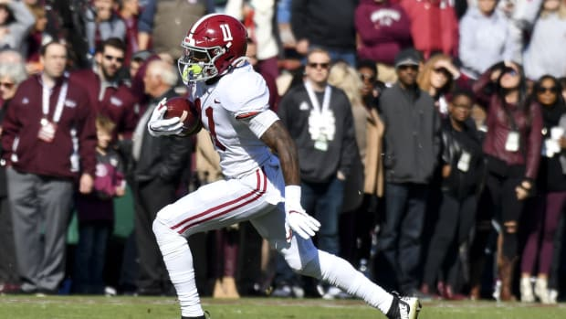 Nov 16, 2019; Starkville, MS, USA; Alabama Crimson Tide wide receiver Henry Ruggs III (11) runs the ball against the Mississippi State Bulldogs during the first quarter at Davis Wade Stadium. Mandatory Credit: Matt Bush-USA TODAY Sports