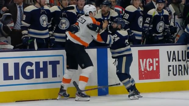 Blue Jackets' Nathan Gerbe fights Flyers' Travis Sanheim in an NHL game