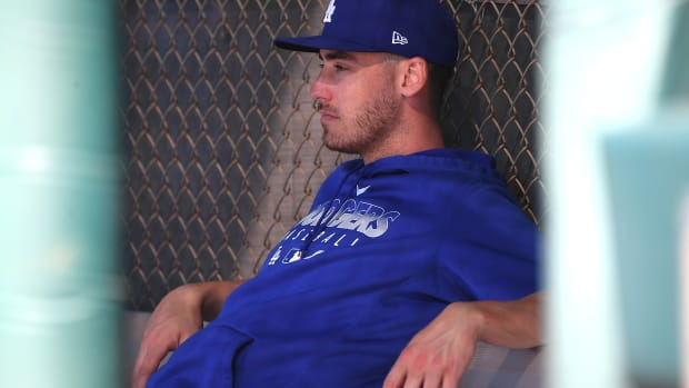 Feb 20, 2020; Glendale, Arizona, USA; Los Angeles Dodgers center fielder Cody Bellinger (35)sits in the dugout as he takes a break during spring training at Camelback Ranch. Mandatory Credit: Jayne Kamin-Oncea-USA TODAY Sports