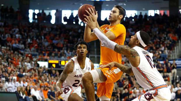 An Auburn fan was tossed for a derogatory comment about Tennessee's Santiago Vescovi.