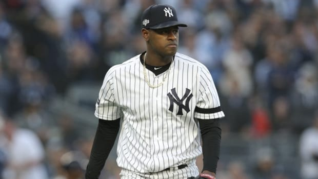 New York Yankees starting pitcher Luis Severino walks off the field during the fourth inning in game three of the 2019 ALCS playoff baseball series against the Houston Astros at Yankee Stadium.