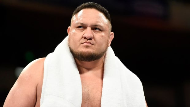 Closeup image of WWE's Samoa Joe in the ring with a towel around his shoulders