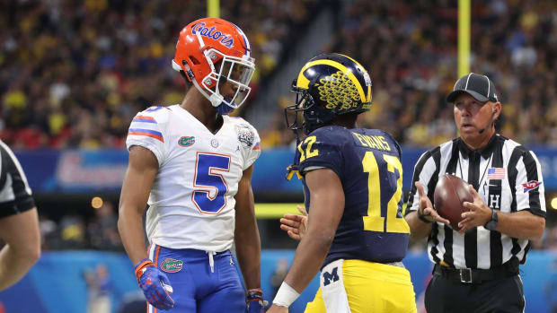 Dec 29, 2018; Atlanta, GA, USA; Florida Gators defensive back CJ Henderson (5) reacts after tackling Michigan Wolverines running back Chris Evans (12) in the first quarter of the 2018 Peach Bowl at Mercedes-Benz Stadium.