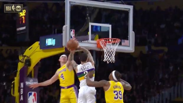 Screenshot from video of Lakers' Alex Caruso blocking Pelicans' Lonzo Ball
