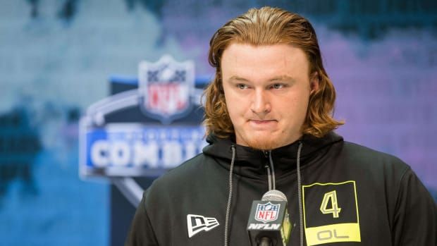 Offensive line prospect Ben Bartch stands at the podium at the NFL draft combine