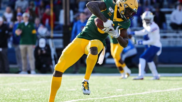 Baylor Bears wide receiver Denzel Mims (5) catches a pass against the Kansas Jayhawks during the first half at David Booth Kansas Memorial Stadium.