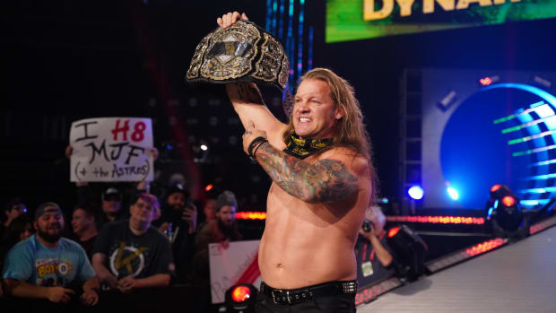 AEW Champion Chris Jericho holds his title belt in the air on Dynamite