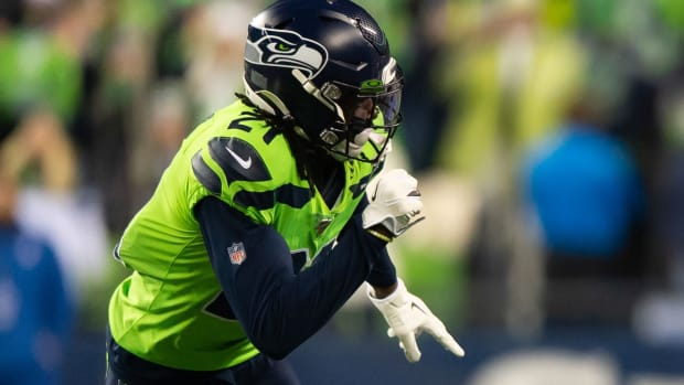 Minnesota Vikings wide receiver Stefon Diggs (14) runs a route while being defended by Seattle Seahawks cornerback Tre Flowers (21) during the game at CenturyLink Field. Seattle defeated Minnesota 37-30.
