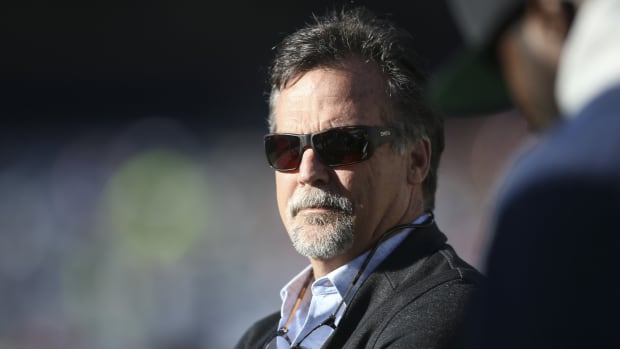 Former NFL head coach Jeff Fisher watches a game between the Birmingham Iron and Atlanta Legends in the first half at Georgia State Stadium.