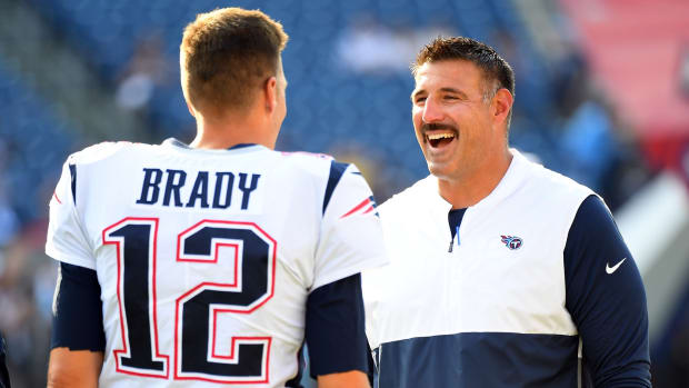New England Patriots quarterback Tom Brady (12) talks with Tennessee Titans head coach Mike Vrabel before the preseason game at Nissan Stadium.