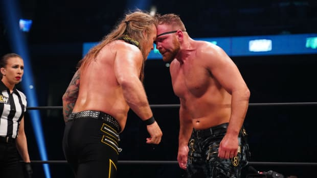 Jon Moxley and Chris Jericho butt heads in the ring during AEW Revolution