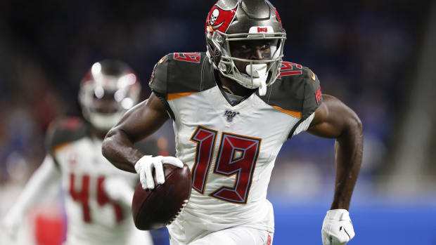 Tampa Bay Buccaneers wide receiver Breshad Perriman (19) runs after a catch for his second touchdown during the second quarter against the Detroit Lions at Ford Field.