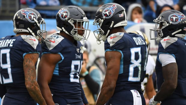 Tennessee Titans tight end Jonnu Smith (81) celebrates with Tennessee Titans wide receiver Corey Davis (84) after a touchdown reception during the first half against the New Orleans Saints at Nissan Stadium.