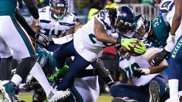 Seattle Seahawks running back Marshawn Lynch (24) scores a touchdown against the Philadelphia Eagles during the second quarter in a NFC Wild Card playoff football game at Lincoln Financial Field.