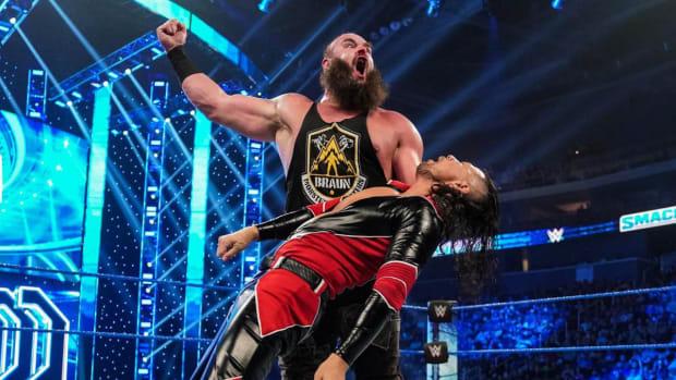 WWE's Braun Strowman wrestles Shinsuke Nakamura in the ring on SmackDown
