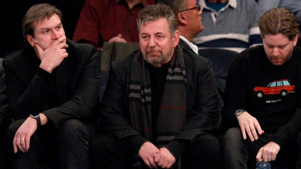 Knicks owner James Dolan sitting courtside at an NBA game