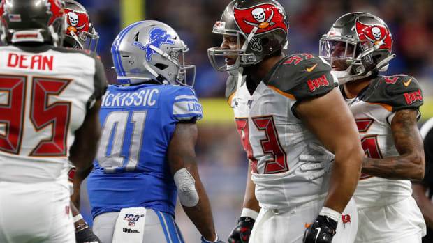 Tampa Bay Buccaneers nose tackle Ndamukong Suh (93) yells at Detroit Lions running back J.D. McKissic (41) during the second quarter at Ford Field.