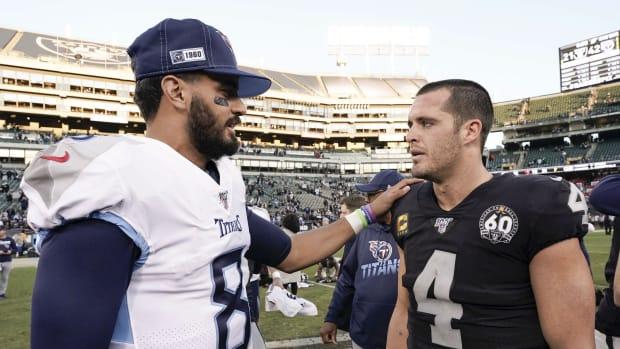 Tennessee Titans quarterback Marcus Mariota (8) speaks with Oakland Raiders quarterback Derek Carr (4) after the game at Oakland Coliseum.