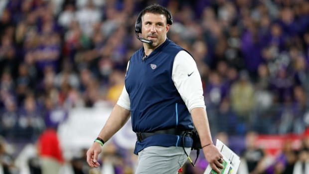 Tennessee Titans head coach Mike Vrabel stands on the field against the Baltimore Ravens in a AFC Divisional Round playoff football game at M&T Bank Stadium.
