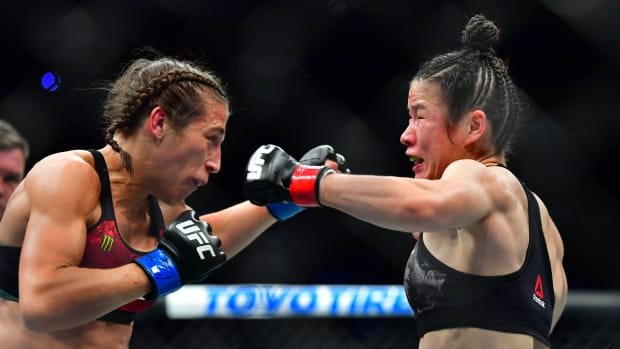 Weili Zhang (red gloves) fights Joanna Jedrzejczyk (blue gloves) during UFC 248 at T-Mobile Arena.