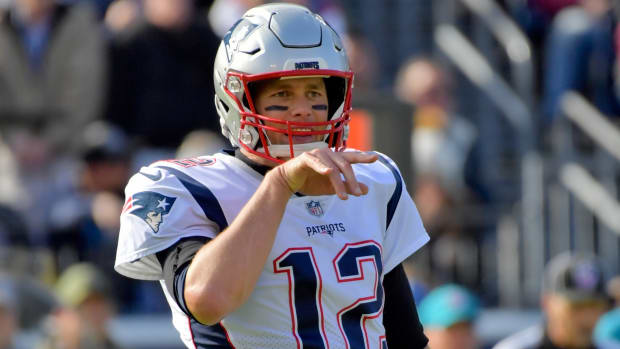 New England Patriots quarterback Tom Brady (12) signals from the line against the Tennessee Titans during the first half at Nissan Stadium.