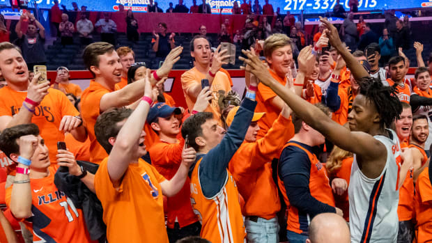 Illinois Fighting Illini guard Ayo Dosunmu (11) celebrates with fans after a game against the Iowa Hawkeyes at State Farm Center.